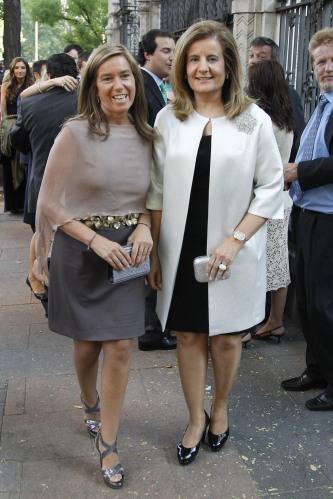 Las ministras de Sanidad, Ana Mato y de Empleo, Fátima Báñez, acudiendo a un festejo en foto de archivo